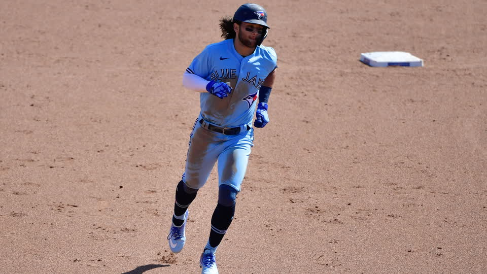 Bichette Launches Home Run over the Green Monster